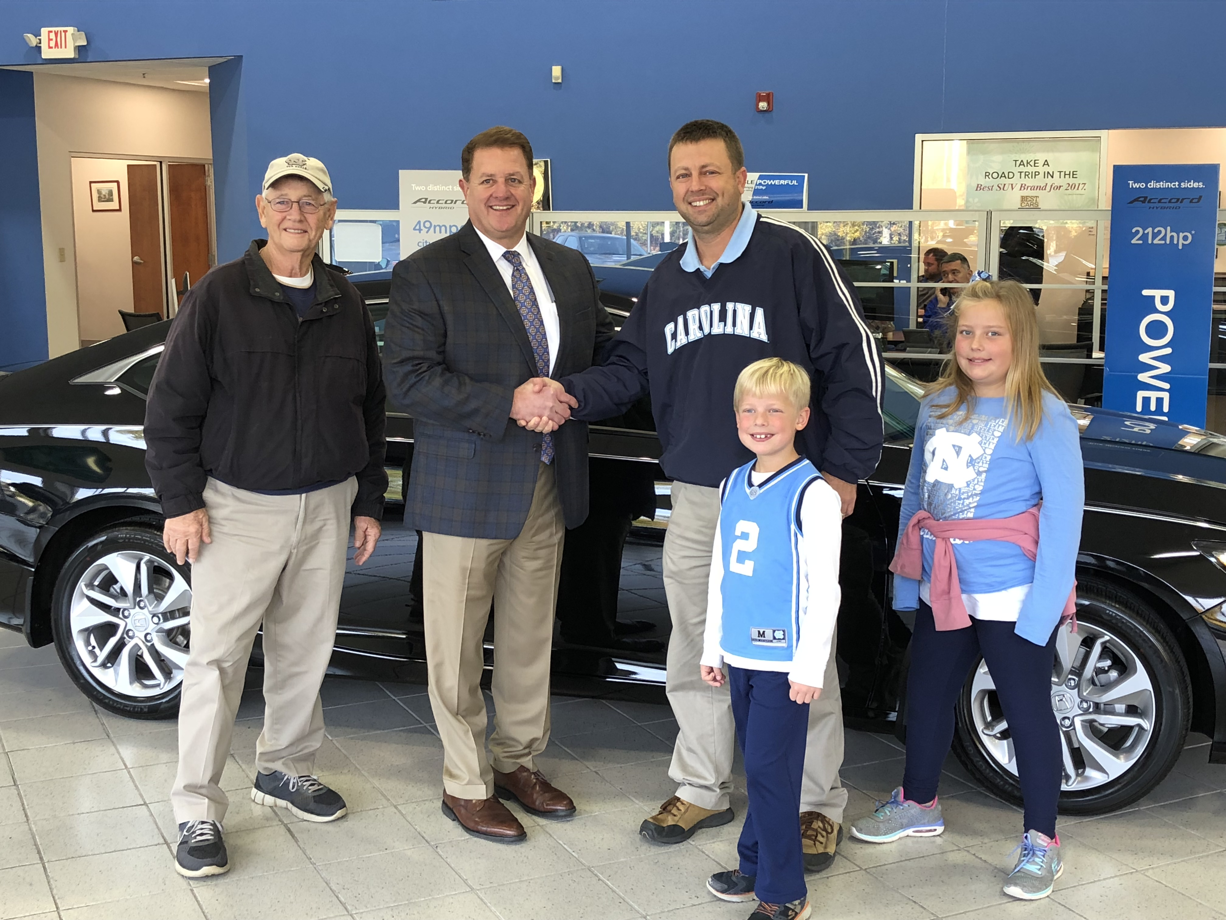 TAR HEELS' FOOTBALL PROMOTION WITH CROWN HONDA OF SOUTHPOINT HAS BELMONT RESIDENT DRIVING AWAY IN NEW CAR